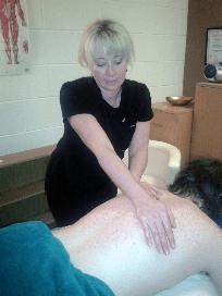 Vivienne Massage Therapist providing a back massage