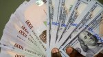 CBN injects $205m as Naira falls to N379/$