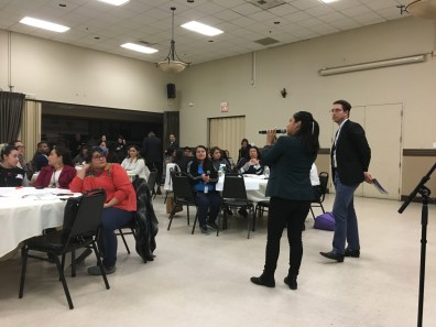 Amanda Meza, Investing in Place's Advocacy and Policy Associate, addresses the crowd about transportation challenges. Pictured with her is Nat Gale from LA DOT's Vision Zero program.