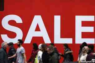 158697147-shoppers-make-their-way-past-a-sale-sign-outside-a.jpg.CROP.promovar-mediumlarge.jpg