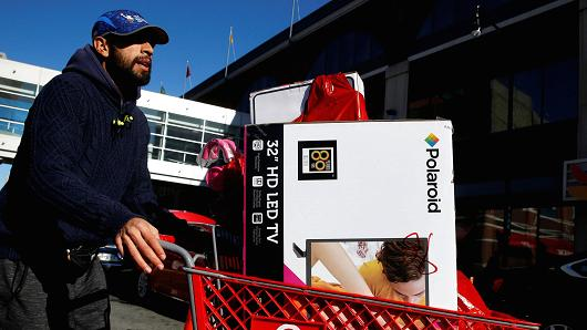 A man pushes a cart load of goods after shopping at a Target store during Black Friday shopping in Brooklyn, New York, November 24, 2017.