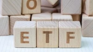 "Three wood blocks spelling out ""ETF"". representing best etfs"