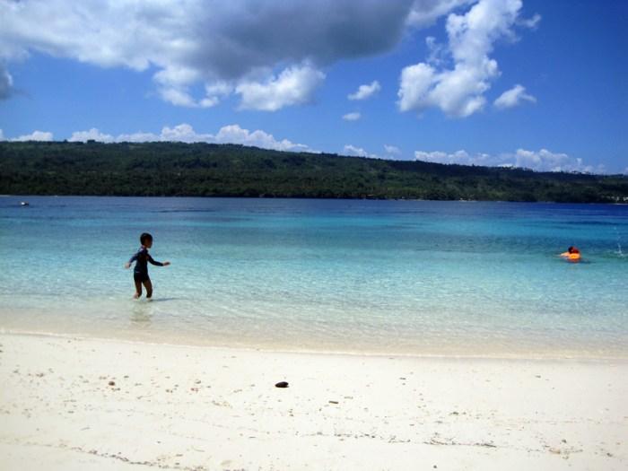 A boy playing in the Gulf of Davao at Isla Reta, Talikud Island
