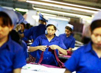 Myanmar in transition: Minimum wage, credit rating, stock exchange