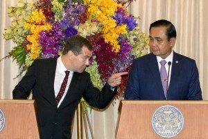 Russia's PM Medvedev speaks with Thailand's PM Prayuth during a news conference at the Government House in Bangkok