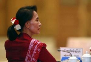 Suu Kyi in red