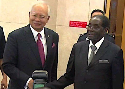 What did Mugabe do in Malaysia?