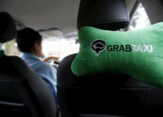 Grab launches service in Cambodia, challenging Uber