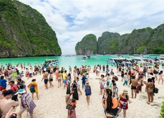"Mass Arrivals Cause ""headache"" For Thai Tourism Minister"