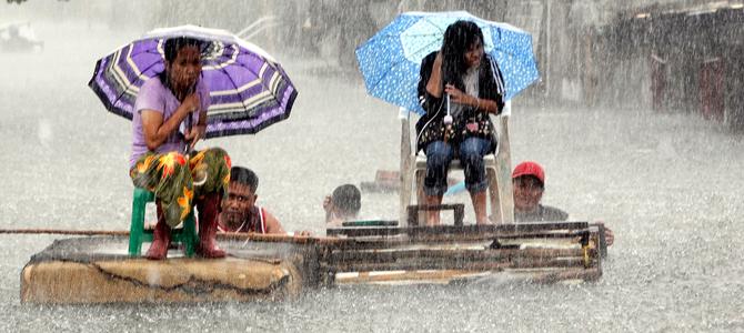 Floods shut down public life, stock market in Manila