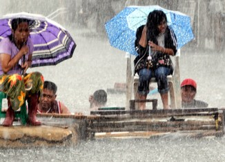 Floods shut down public life, stock market in Manila