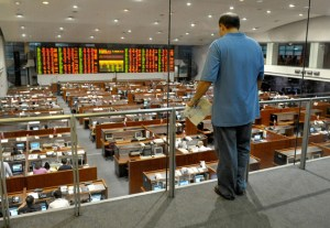 A visitor observes trading at the public