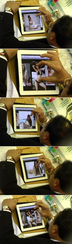Thai MP caught looking at raunchy photos on iPad during session
