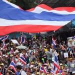 Tensions dense in Bangkok as 10,000s rally