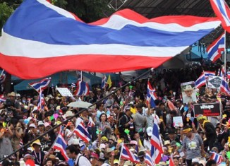 Tensions dense in Bangkok as 10,000s rally