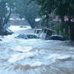 Floods halt business in Manila, Penang