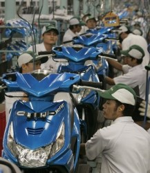 Workers work at the Honda motorcycles factory in Cikarang, Indonesia's west Java province