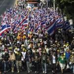 ADB warns Thailand to change politics, address debt