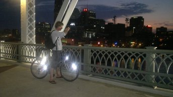 Jan taking a picture of the Nashville cityscape after a long day cycling.