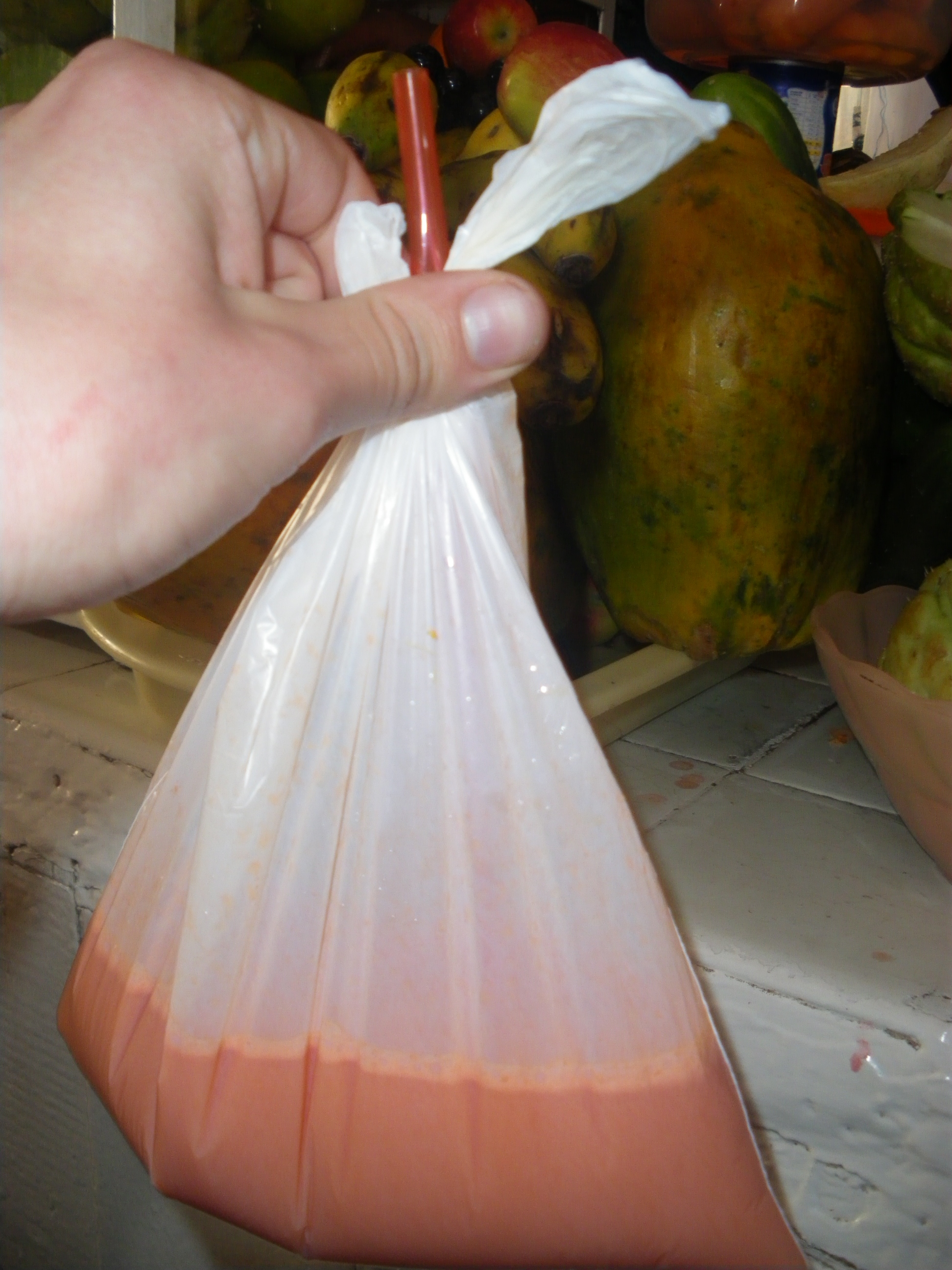 A sack of fresh squeezed orange-carrot juice.  To-go in Peru means in a bag, no matter what.