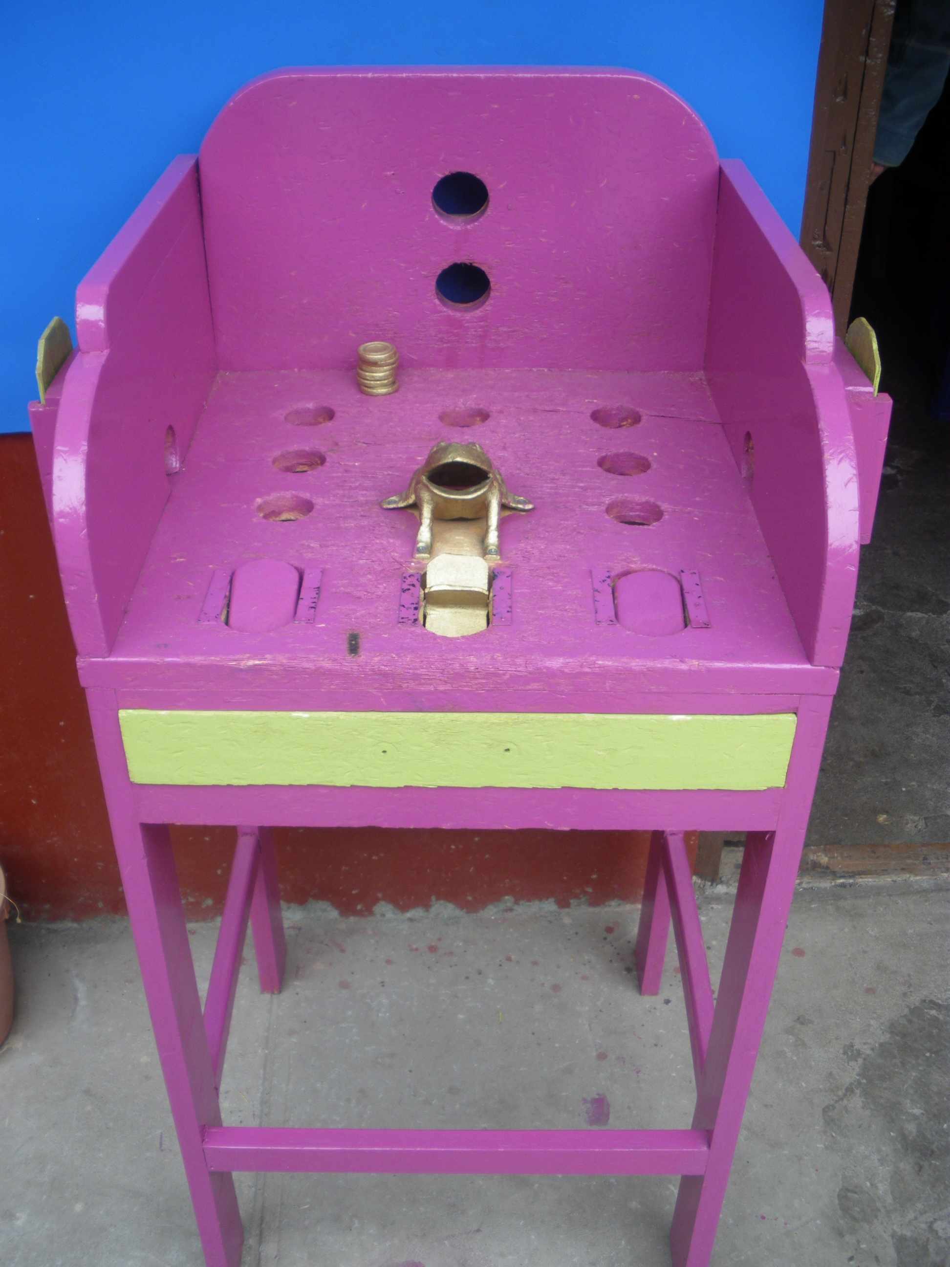 A popular game in Peru called Sapo.  Throw the gold coins into the frog´s mouth.