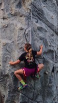 Madi, age 11, rock climbing during a flare