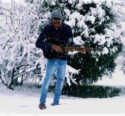 Sellars playing guitar in snow