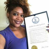 Jaime with a proclamation signed by Virginia Governor recognizing the month of June as National Migraine and Headache Awareness Month