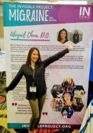 Dr. Abby Chua in front of her display at the American Headache Society Conference