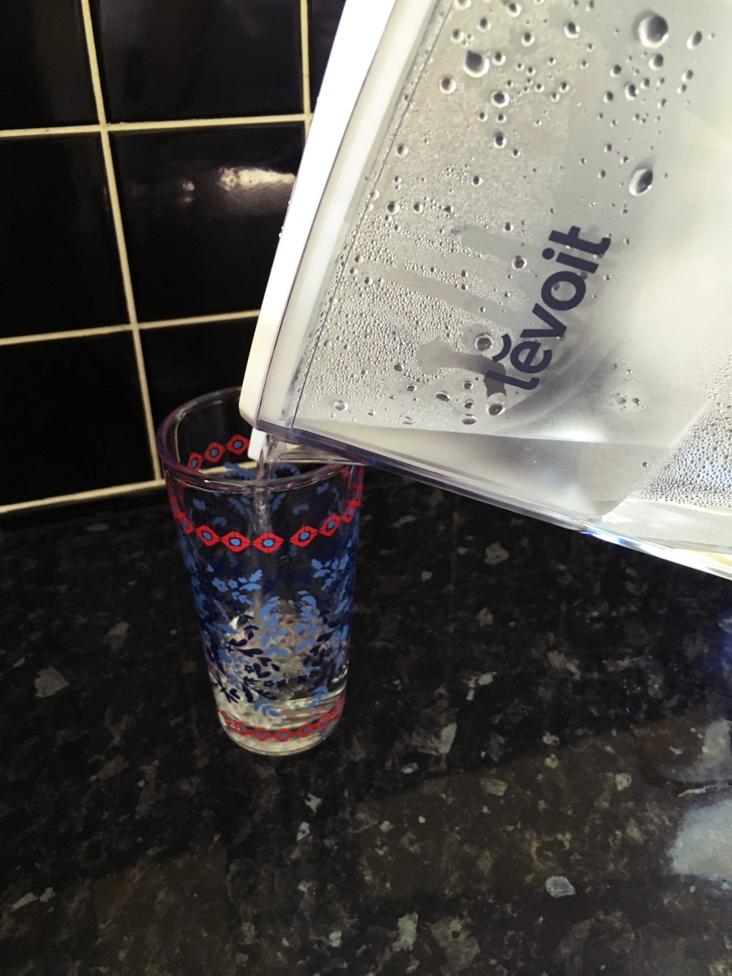 A photograph of water being poured from the Levoit water filter jug in my kitchen.