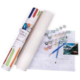 A birds-eye view of the Winnie's Picks giveaway prize, with the tube for the rolled-up paint by numbers canvas, paintbrushes and paints.