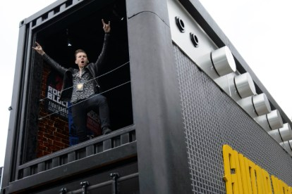 EDITORIAL USE ONLY Danny Jones from McFly celebrates the launch of Guitar Hero Live by recreating the ultimate rock star moment Ð throwing a TV out of a first storey window at LondonÕs Truman Brewery. PRESS ASSOCIATION Photo. Picture date: Thursday October 22, 2015. Guitar Hero Live, available nationwide tomorrow, completely reimagines the pop culture phenomenon, placing you centre stage with live-action gameplay and introduces GHTV, the worldÕs first playable music video network. Photo credit: Matt Crossick/PA Wire