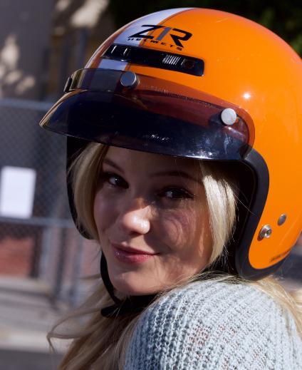 STANDOFF#21 - Olivia Holt - Amy (Olivia Holt) poses in her scooter helmet.