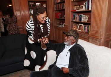 """Ava DuVernay and Clarence Avant seen at Netflix's original documentary """"13TH"""" reception hosted by Netflix Chief Content Officer Ted Sarandos and Ambassador Nicole Avant with a special conversation moderated by Oprah Winfrey with director Ava DuVernay and Van Jones] on Sunday, January 15, 2017, in Los Angeles, CA. (Photo by Eric Charbonneau/Invision for Netflix/AP Images)"""