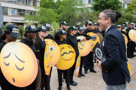 LONDON, ENGLAND - July 17, 2017: Jack Brockbank (Guinness World Record official Adjudicator) fans getting ready to set the Guinness World Record for the largest gathering of people dressed as emoji faces in celebration of World Emoji Day and Columbia Pictures' THE EMOJI MOVIE.