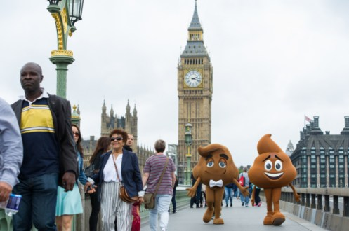 LONDON, ENGLAND - July 17, 2017: Emoji hanging out in front of Big Ben in celebration of World Emoji Day and Columbia Pictures' THE EMOJI MOVIE.