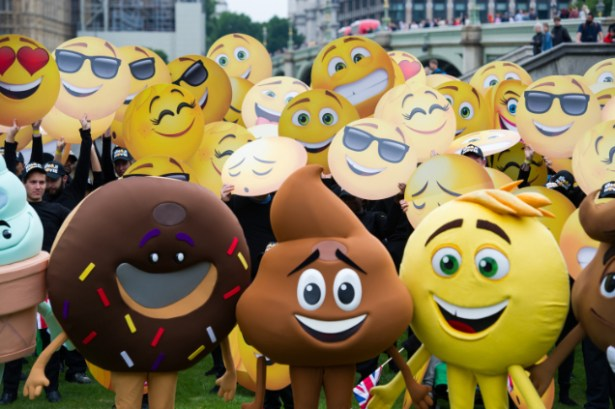 LONDON, ENGLAND - July 17, 2017: Emoji in St. Thomas Hospital Garden setting the Guinness World Record for the largest gathering of people dressed as emoji faces in celebration of World Emoji Day and Columbia Pictures' THE EMOJI MOVIE.