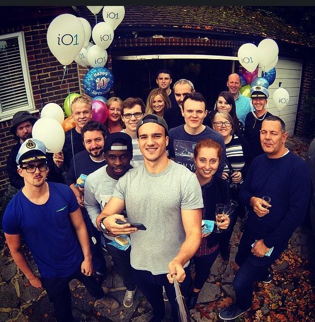 io1 team group photo with io1 balloons
