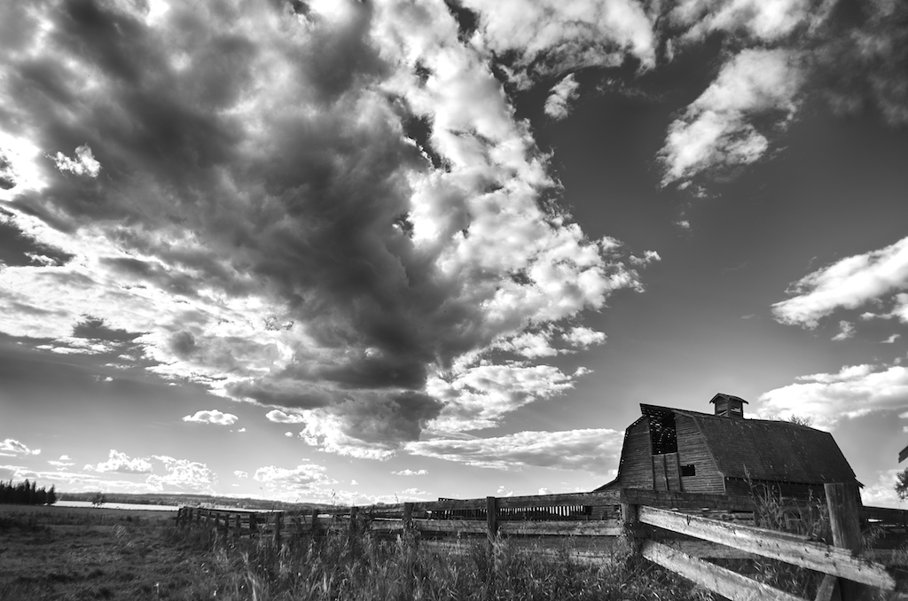barn-sky-clouds-fence