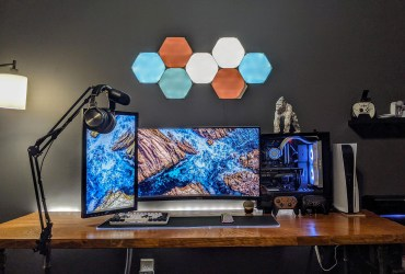 An inviting and cozy battlestation desk setup for programming and casual gaming