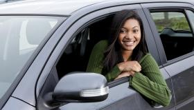African American teenage girl driving car