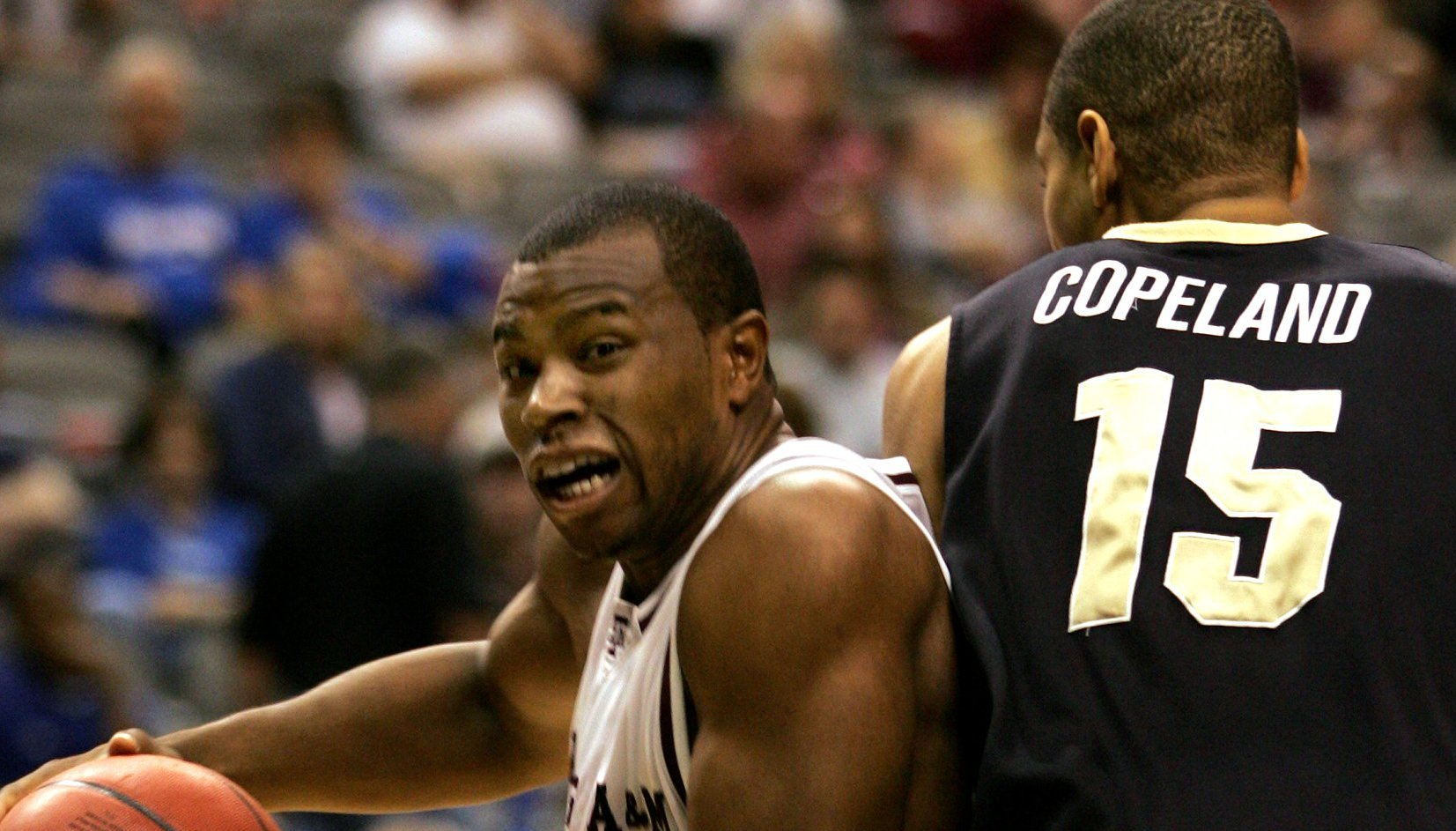 Texas A&M's Joseph Jones, left, drives around Colorado's Chr