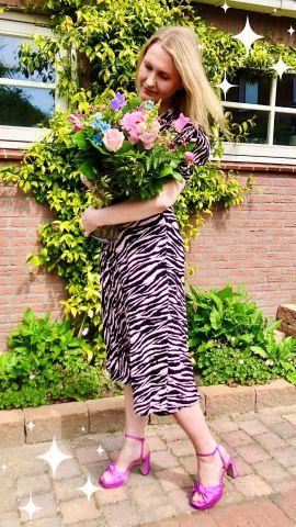 Wearing a pink fantasy zebra/tiger print dress