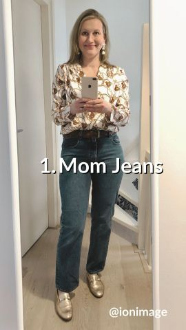 Wearing a printed shirt wit mom jeans