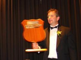 Steve Davis holding the AJ & RJ Loader Sponsor's Display Shield