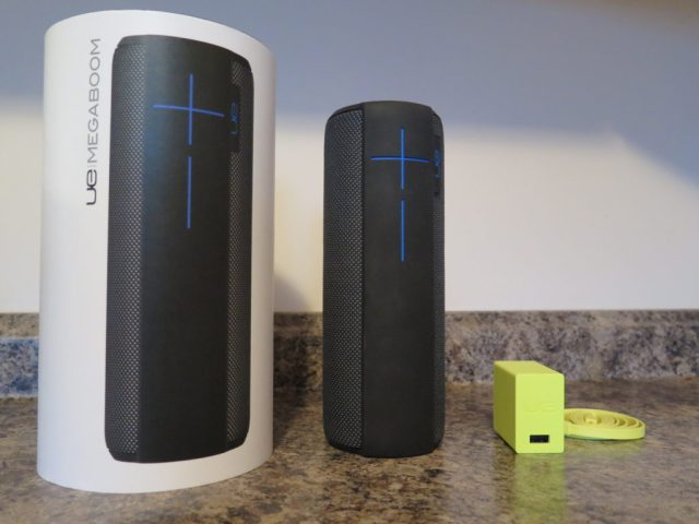 The MEGABOOM, it's packaging, and the power adapter.