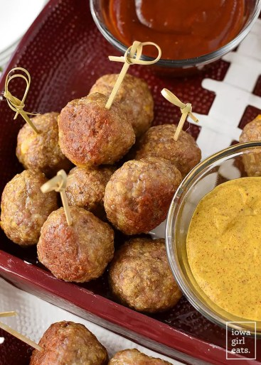 Cheddar Brat Meatballs are homemade bratwurst stuffed with gooey cheddar cheese. Serve with three, easy flavor-packed dipping sauces! #glutenfree | iowagirleats.com