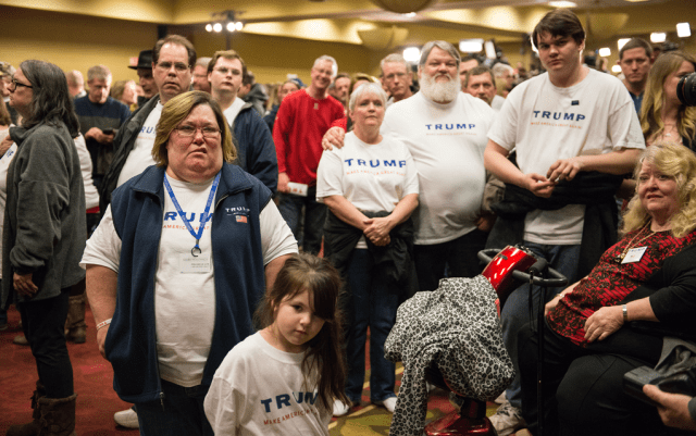 Des Moines resident Tammy Schmidt, 48, who attends Trump's caucus-night rally in West Des Moines with her niece, scoffs as the GOP race is called for Cruz. Photo: Jon Lemons/Iowa Informer