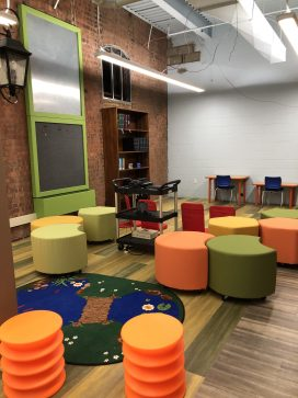 Picture of youth library space seating and lego activity center.
