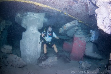 Not much room between the sea floor and the barge as she sits up side down.   Here is a scale shot - one muoi head burried in the sand.